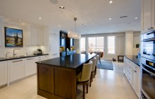 Large open concept kitchen with center island in Lake Calhoun remodel.