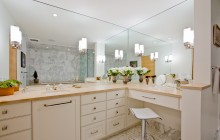 Huge bathroom mirrors for views from every angle in Minneapolis remodel.